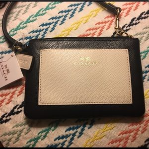 NWT Navy and Ivory Coach Wristlet
